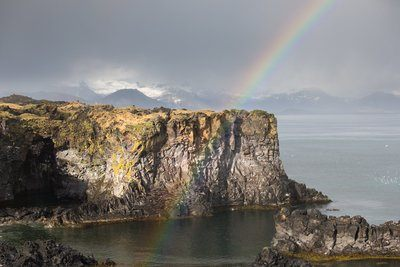 Rainbow And Rock Cliff