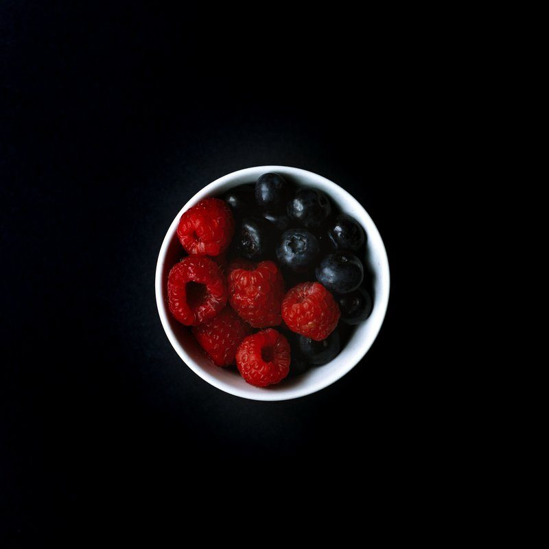 Raspberries And Blueberries In Dish