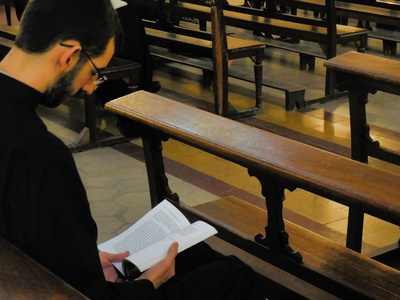 Reading and praying in church
