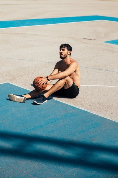 Resting On Basketball Court