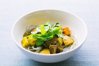 Round White Ceramic Bowl with Sliced Meat And Vegetable on Gray