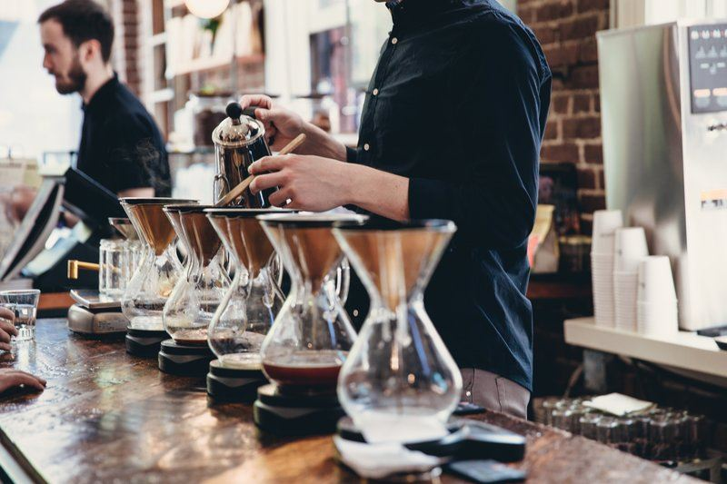 Row Of Pour Over Coffee Being Brewed