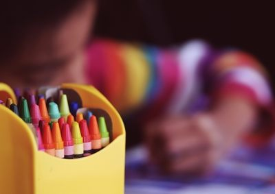 Selective Focal  Crayons in Yellow Box