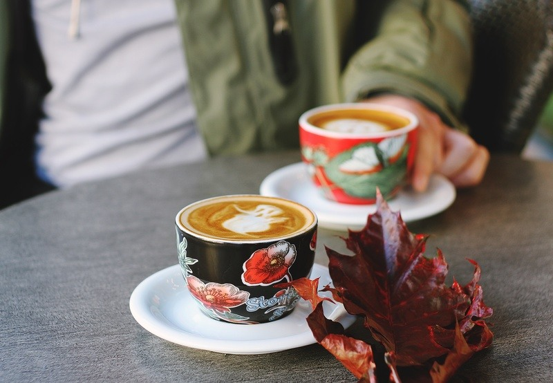 Selective Focus  Black Floral Cup on White Saucer with