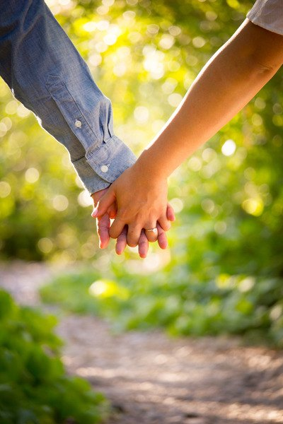 Shallow Focus  Man And Woman Holding Hands