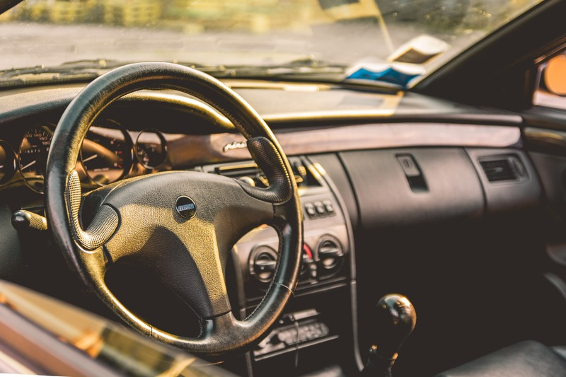 Shallow Focus Photography of Car Steering Wheel
