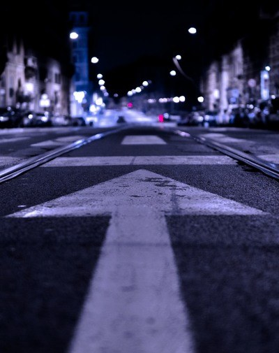 Shallow Focus Photography of Road with Forward Arrow Illustration