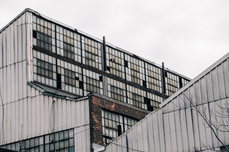 Shattered Windows In Grey Buildings