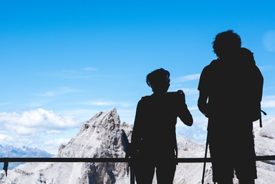 Silhouette Photography of Two Person Standing on Top