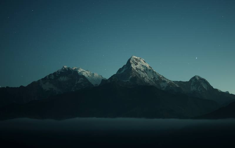 Silhouette of Mountains During Nigh Time