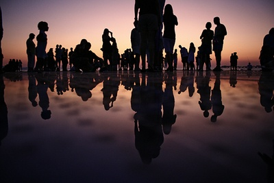 Silhouette of People Standing on Mirror