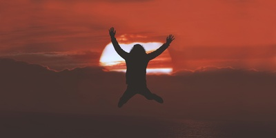 Silhouette of Person Doing Jumpshot at Sunset