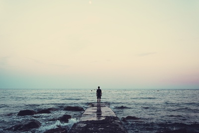 Silhouette of Person Standing on Sea Dock