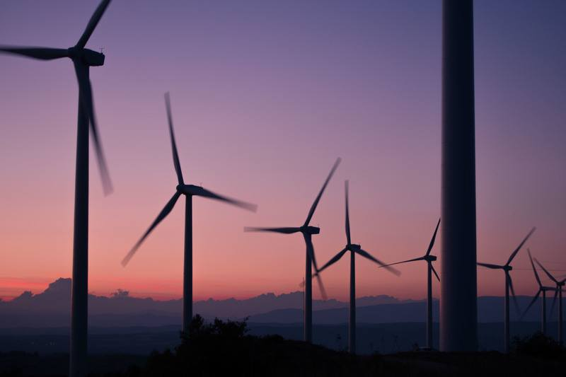 Silhouette of Wind Turbines at Sunset