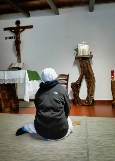 Sister at the feet of Jesus