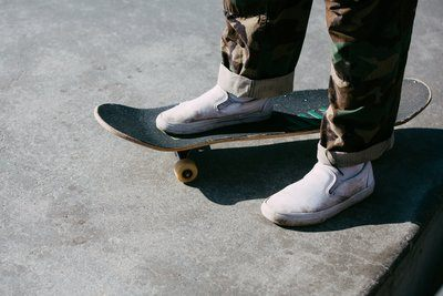 Skater Standing With One Foot On The Board