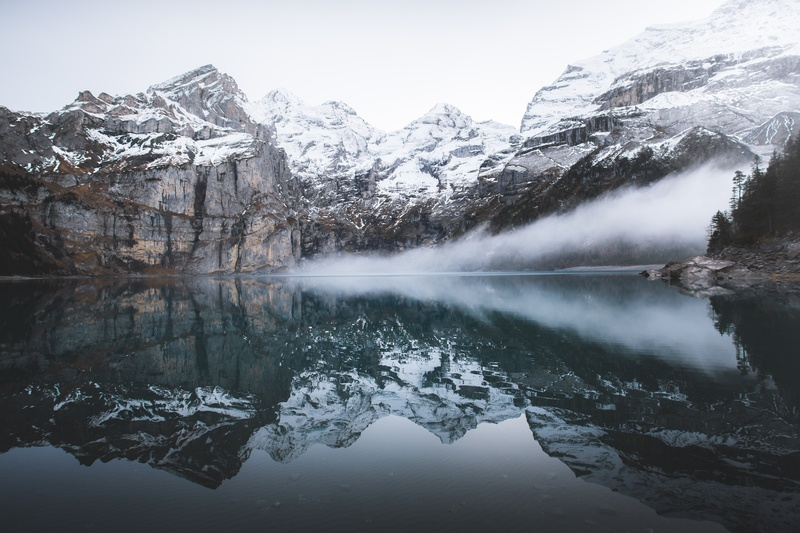 Snow Covered Mountain Near Reflecting on Water