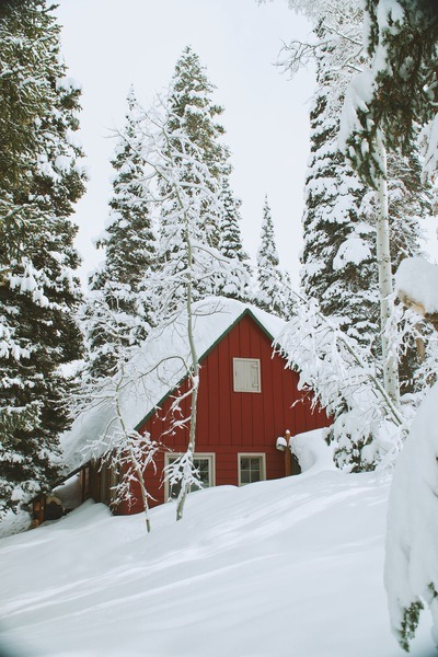Snow Covered Wooden House
