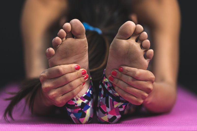 Stretching Woman Hands Feet
