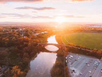 Sunset Over A River Paints The Stony Bridge Gold
