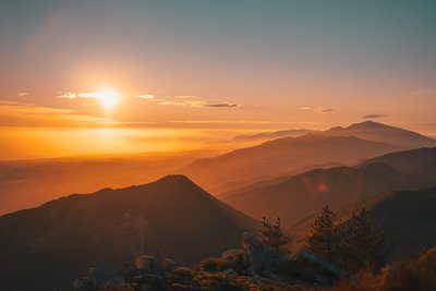 Sunset Over Foggy Mountains
