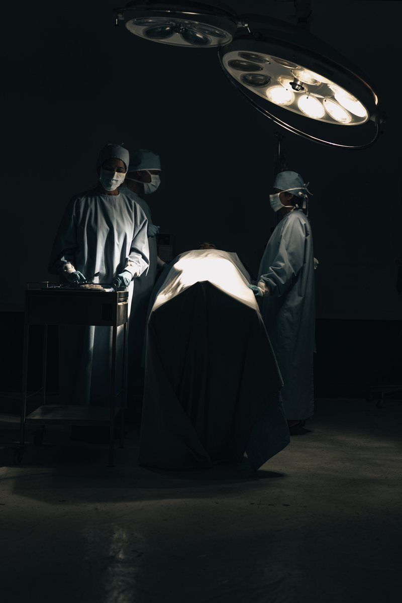 Surgeons Prepare for Surgery In An Operating Room