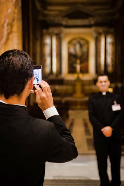 Taking a picture of the priest
