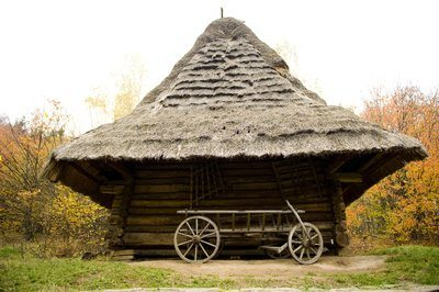Thatched Hut And Wooden Cart