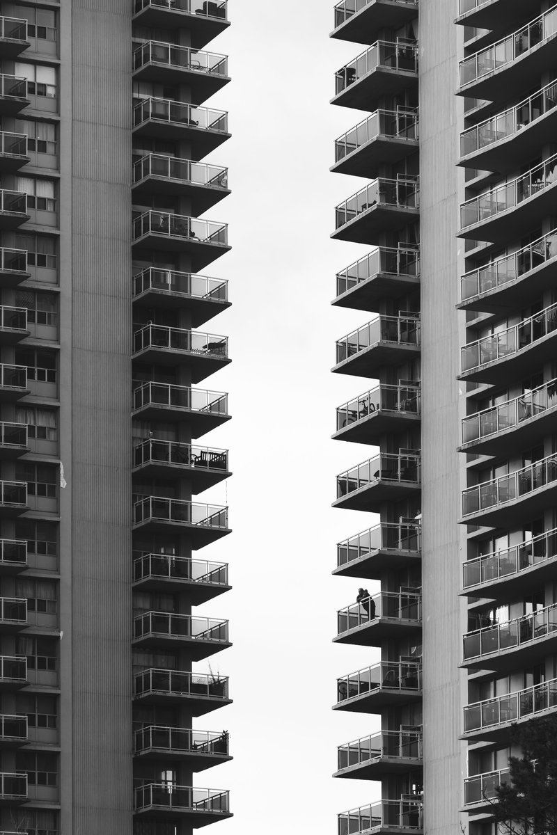 The Terraces Of Two Council Blocks Cut Shapes In the Grey Sky
