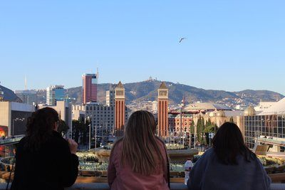 Three Friends Look Out Over City