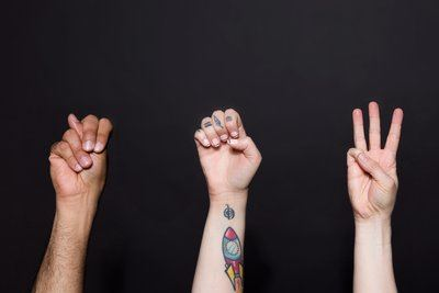 """Three Hands Sign The Word """"New"""""""