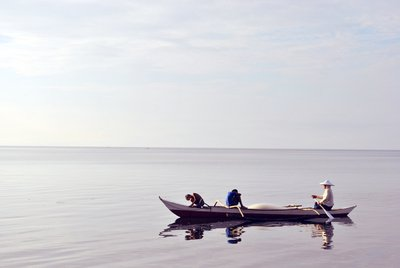 Three Person Riding Canoe At Sea