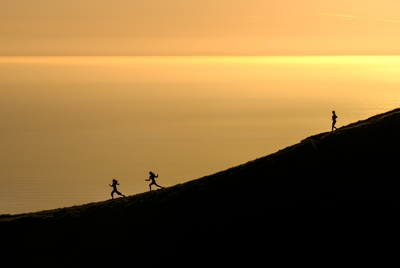 Three Persons Running Downhill