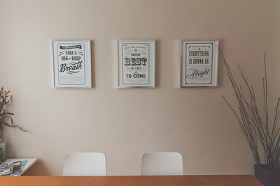 Three Rectangular Quotes on White Painted Wall