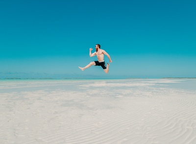 Time Lapse Photography of Man Jumping At Seashore