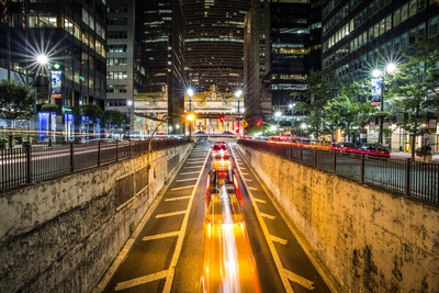 Time Lapse Photography of Vehicle Passing on Concrete Road Surround High-Rise