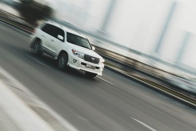 Time Lapse Photography of White Sport Utility Vehicle