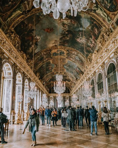 Tourists Beneath Frescoes At Versailles