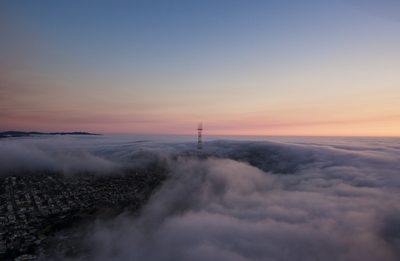 Tower Surrounded By Clouds