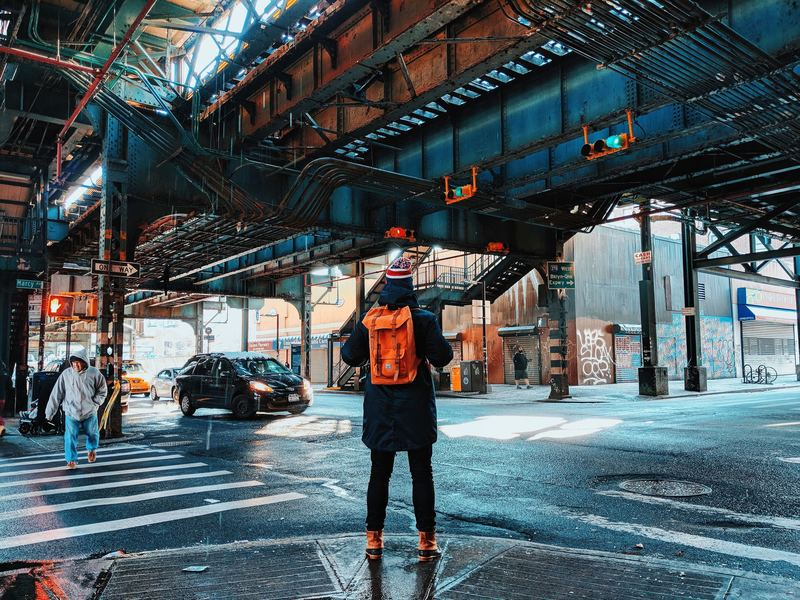 Traveller In NYC with Backpack Under Bridge