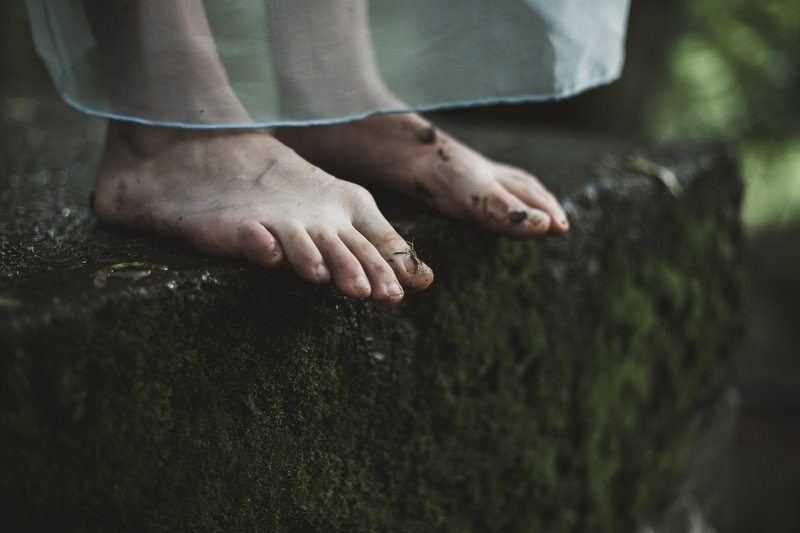 Two Dirty Feet On Mossy Ground