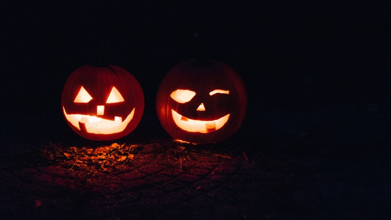 Two Lighted Jack-O-Lanterns at Night Time