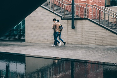 Two Man Walking Beside Stair And Water