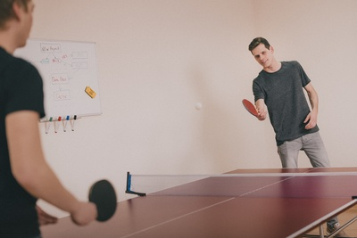 Two Men Playing Ping-Pong inside Room