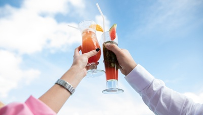 Two Person Holding Clear Drinking Glasses
