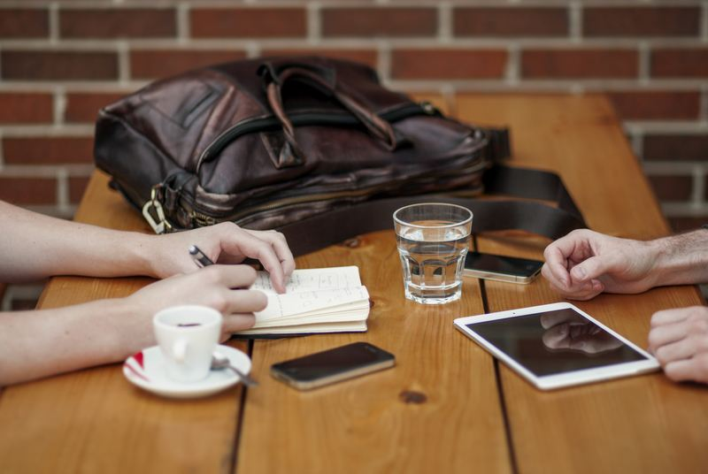 Two Person Sitting in Front of Table