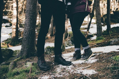 Two Person Wearing Black Pants And Black Shoes Standing Near Trees