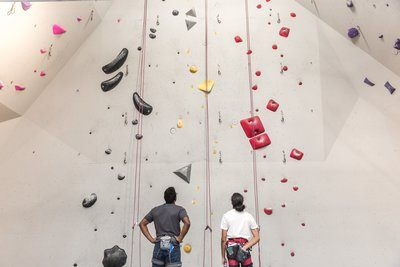 Two Rock Climbers Plan Their Route Together
