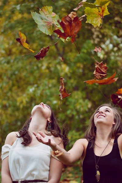 Two Women Throwing Leaves