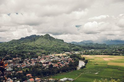 Valley Of Rice Farms Surrounded By Lush Mountains
